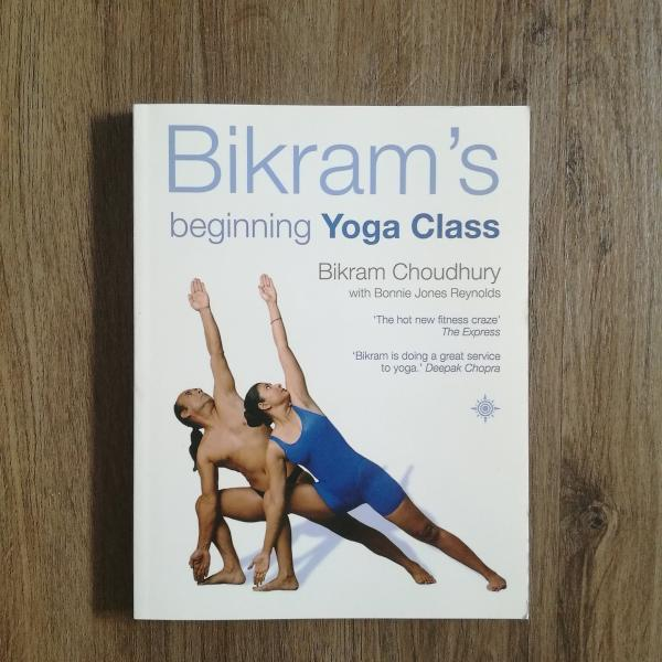 Picture of bikrams beginning yoga book in white cover