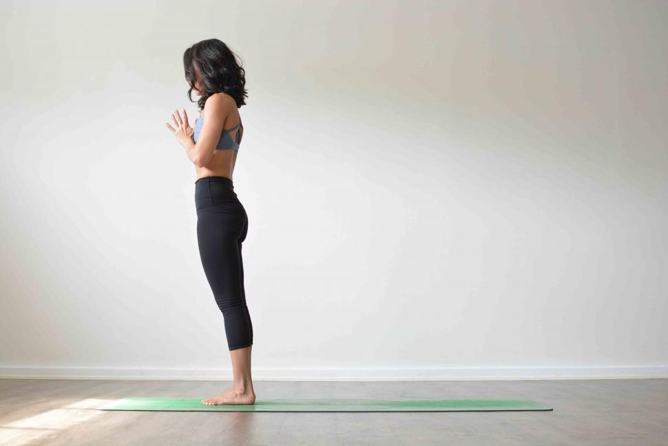 Woman standing in Mountain pose yoga challenge